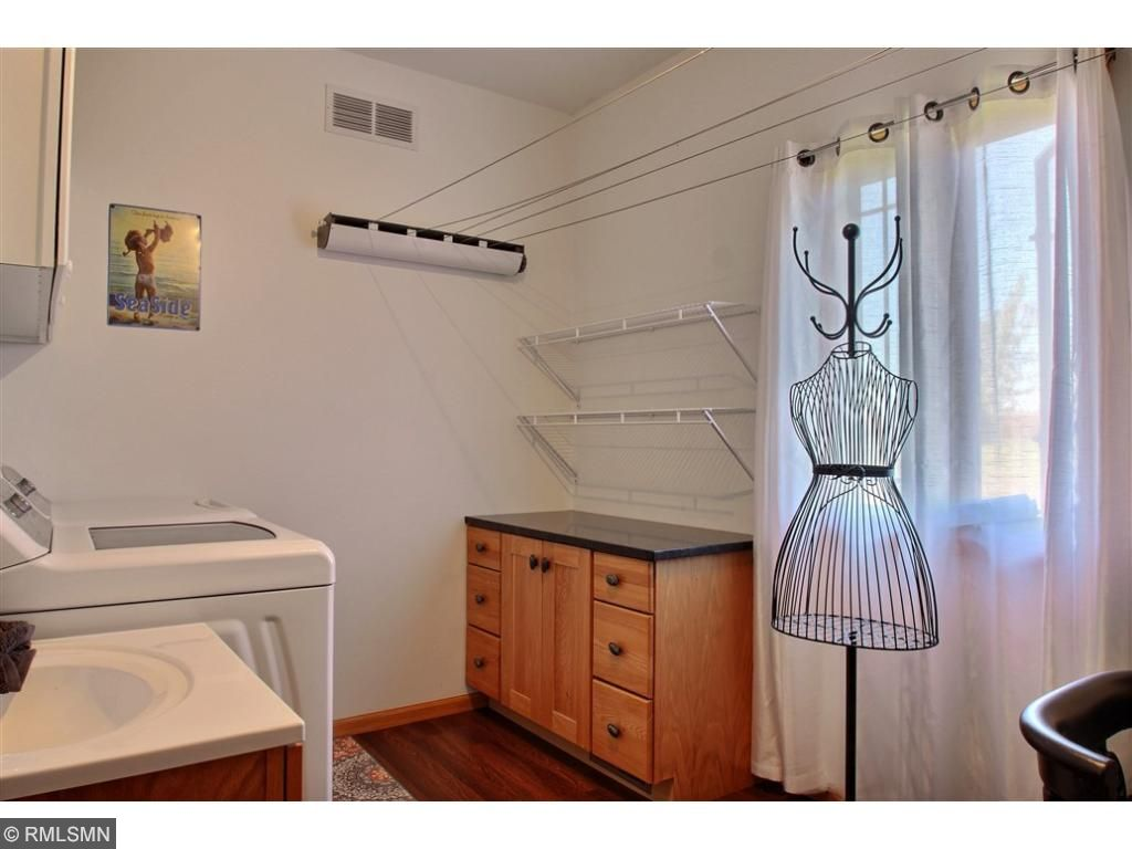 Spacious laundry room located near the bedrooms. No stairs here to go up or down, all living facilities are on one level.