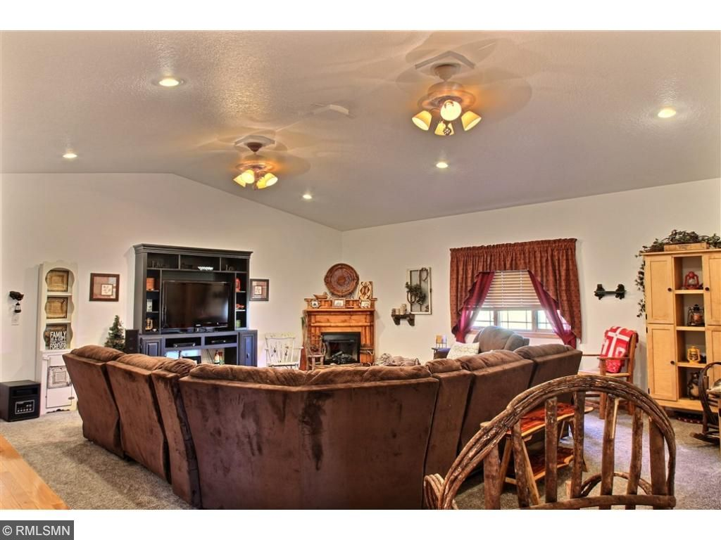 Huge family room with vaulted ceiling with room for everyone. Picture a large family gathering over the holidays.