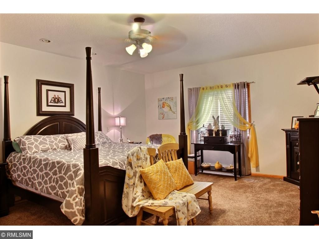 The spacious master bedroom offers a large walk in closet and private bathroom.