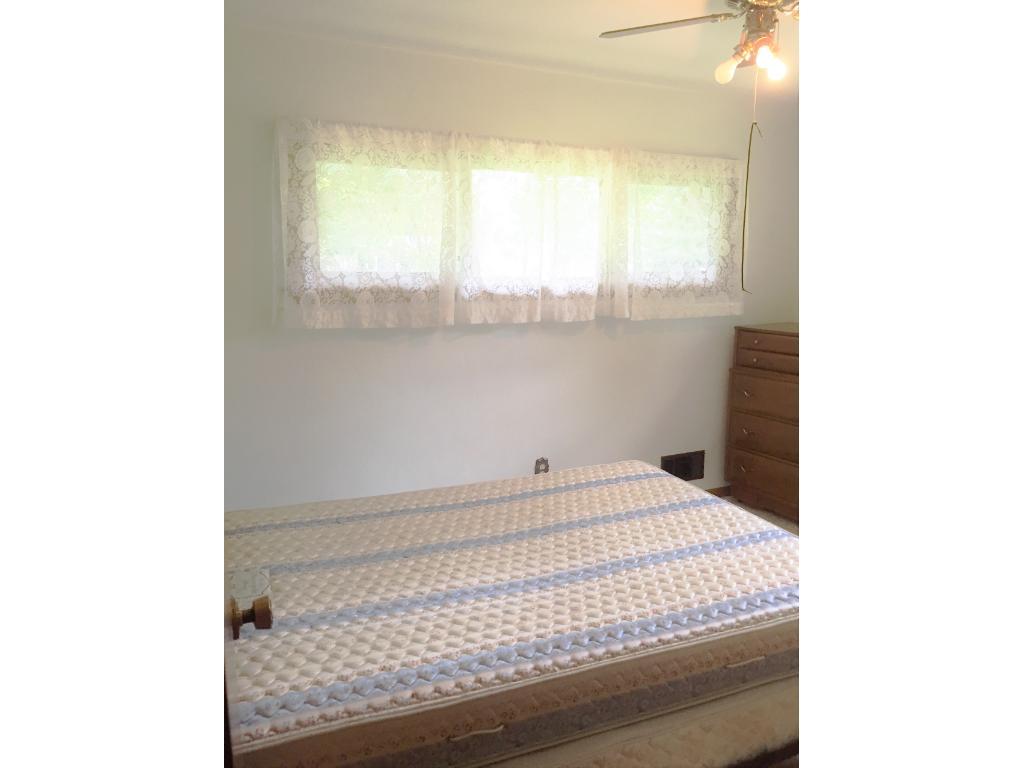 3rd Main floor Bedroom with Hardwood flooring