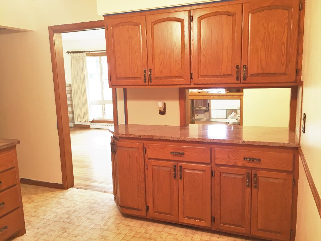 Large pass through into the Dining room and lots of cabinets space