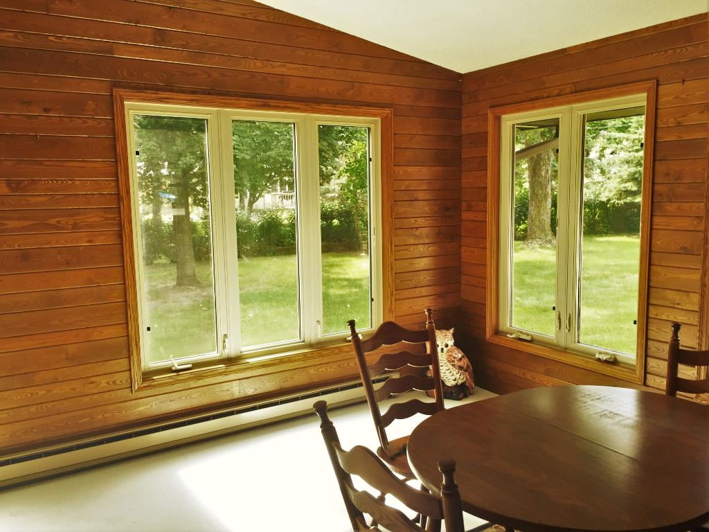 Huge sun room looking off into the back your half acre park like yard.
