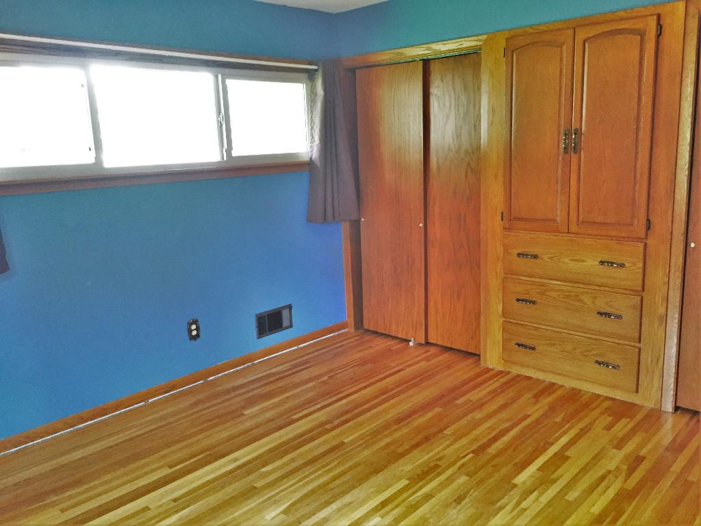 Large Master Suite with built in cabinets and two closets and hardwood floorings