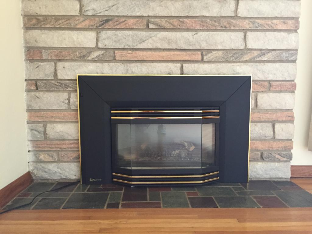 Gas fireplace with Granite stone surround and ledge.