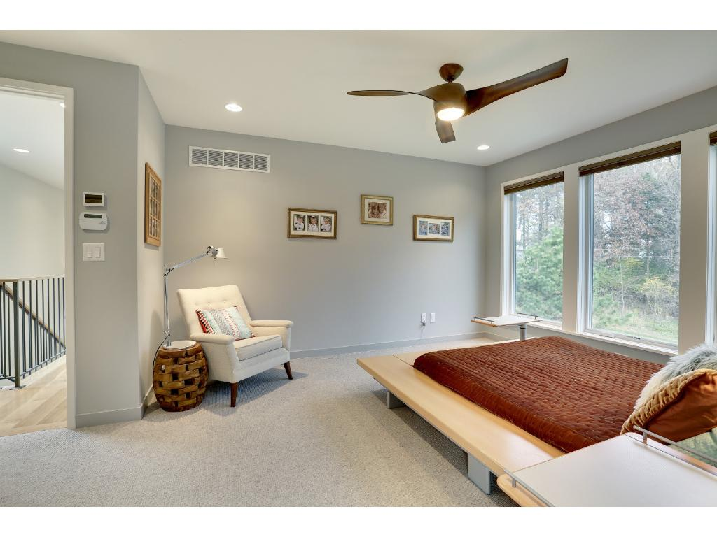 Fantastic loft area on the upper level with wood floor and windows to the front yard.