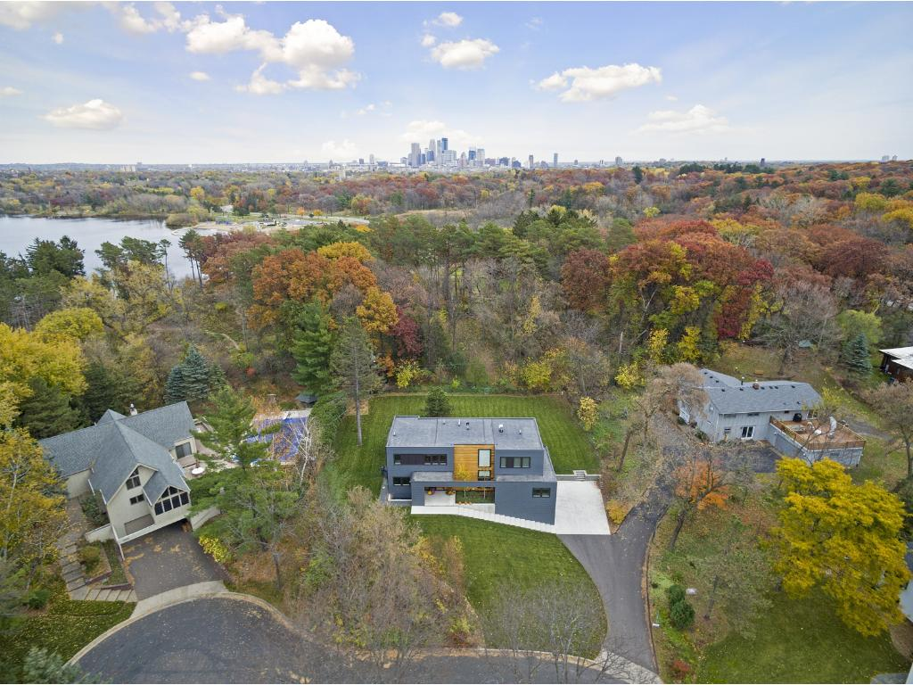 This luxuriously appointed 3BR/4BA two story is artfully situated on a fabulous lot in a perfect location only five miles from downtown Minneapolis - a commuter??s dream!