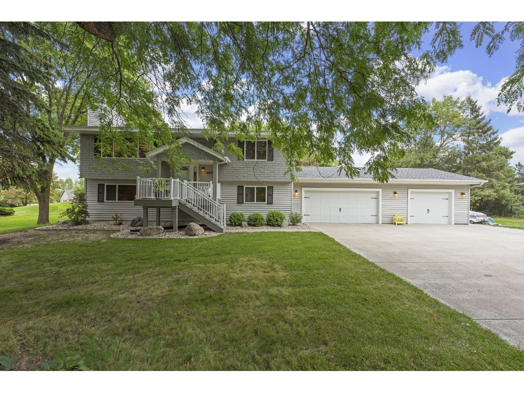 Welcome home to this completely redone home in 2014!  Everything is new!  Notice the concrete driveway that is extra wide.  Home sits on wooded 1/2 acre lot.