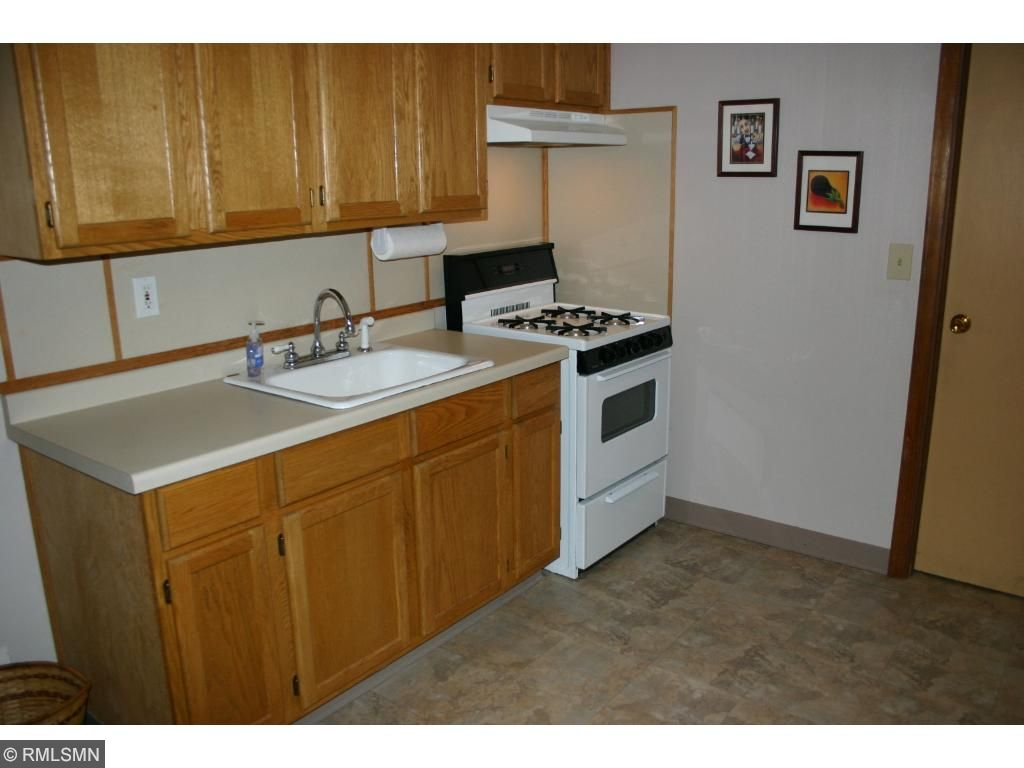 Lower level has plenty of living space with small kitchen, fourth bedroom, bathroom, and living room.