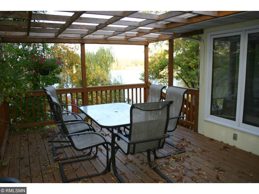 Deck with lattice roof is great for barbecues.