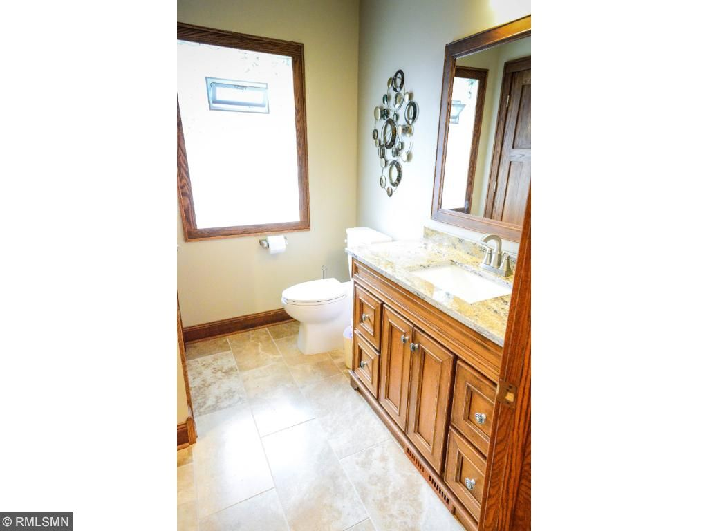 Fully updated bathroom with heated tile floor, new vanity and fixtures. Check out the integrated bathroom fan/light that also has a Bluetooth connected speakers in it!