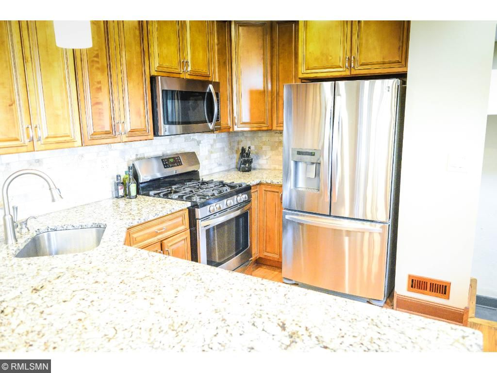 New granite countertops and stainless steel appliances.
