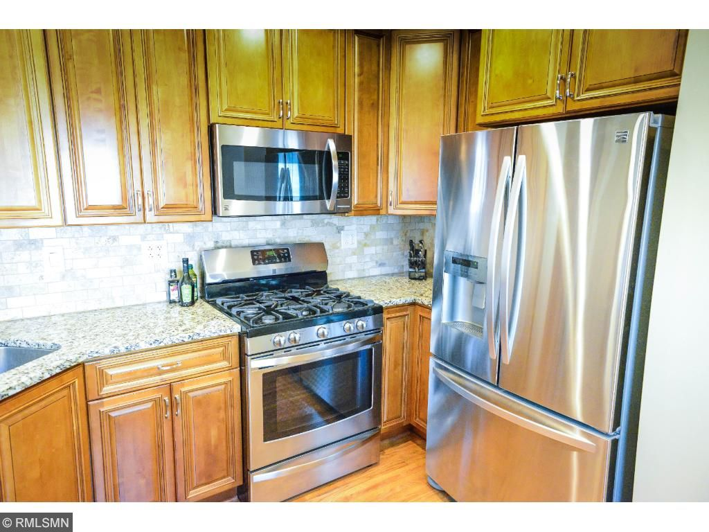 Fully updated kitchen with new custom cabinets are the highlight of this wonderful home.