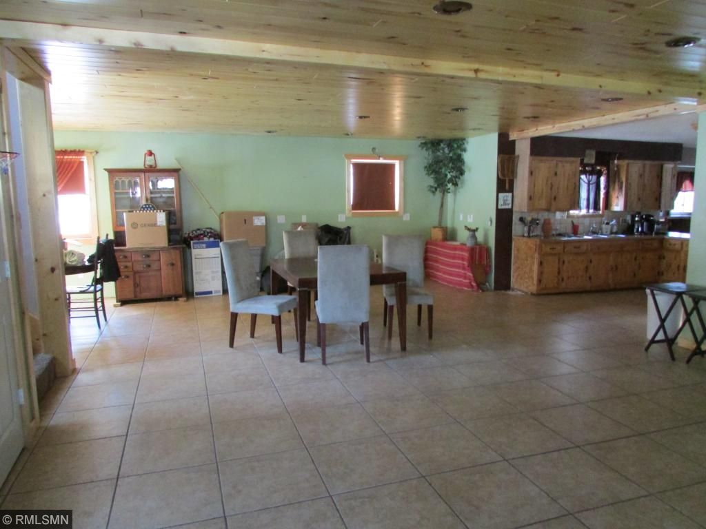 Large open area on the fenced yard side of the center kitchen area/ lots of room!!! Would be a great rental house for snowmobilers/atvr's too