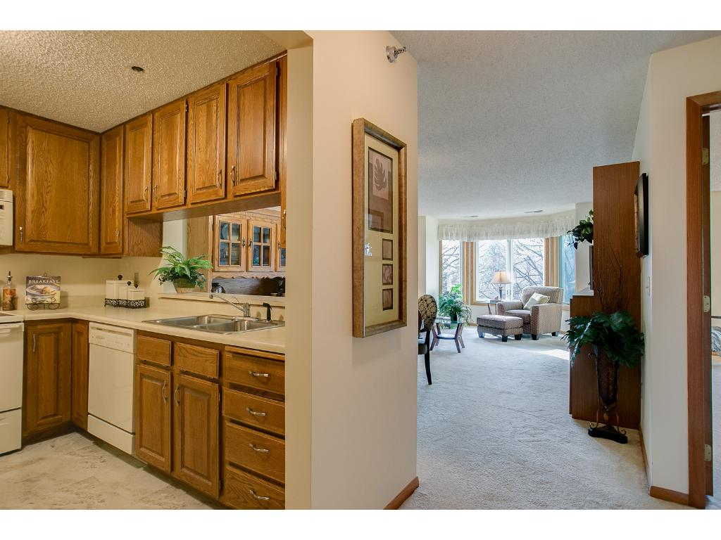 Kitchen opens to living room, eat in breakfast bar.