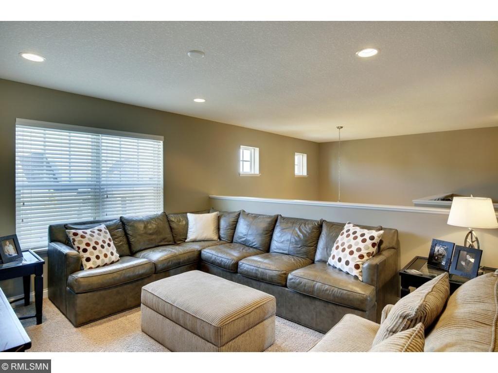 The upper level boasts a bonus family/great room!