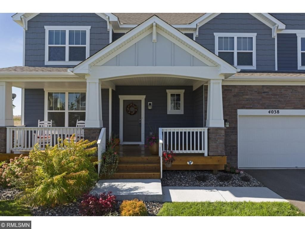 Welcoming curb appeal and restful front porch! The garage includes 3 parking spaces: 1 single and 1 tandem.