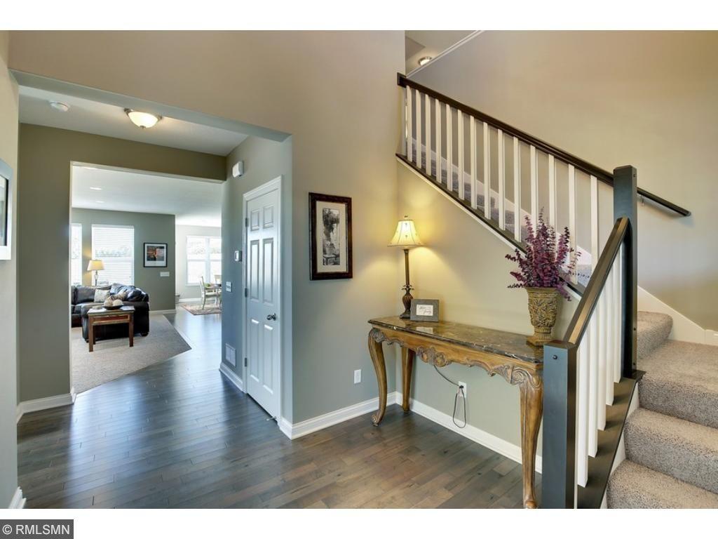 Two-story foyer with gorgeous maple hardwood floors.
