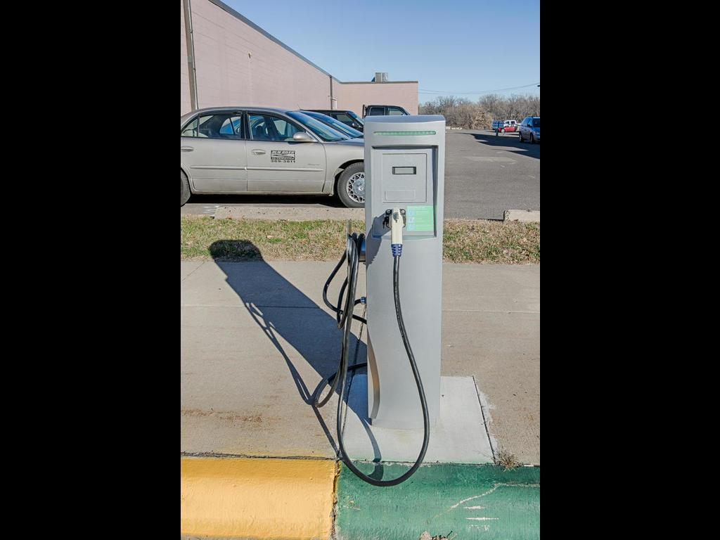 Electric car charging station located outside entrance