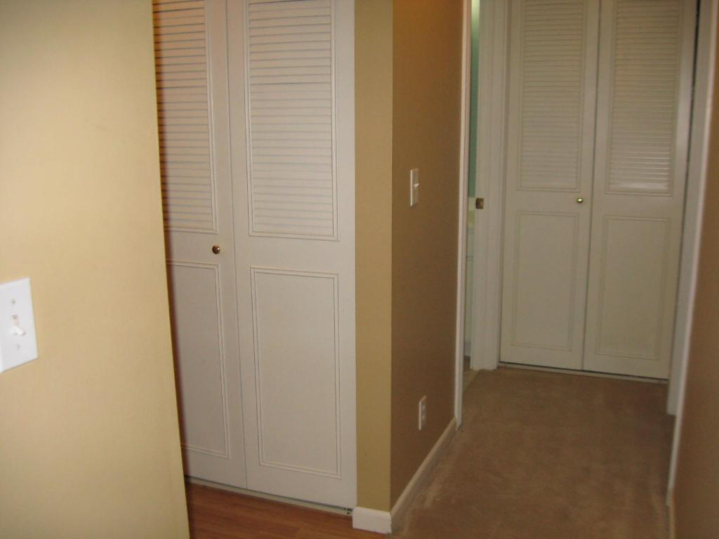 THIS PICTURE IS TAKEN FROM THE LIVING ROOM TO THE ENTRY AND DOWN THE HALLWAY TO THE BATHROOM AND BEDROOM. END OF THE HALL WAY IS THE LINEN CLOSET.
