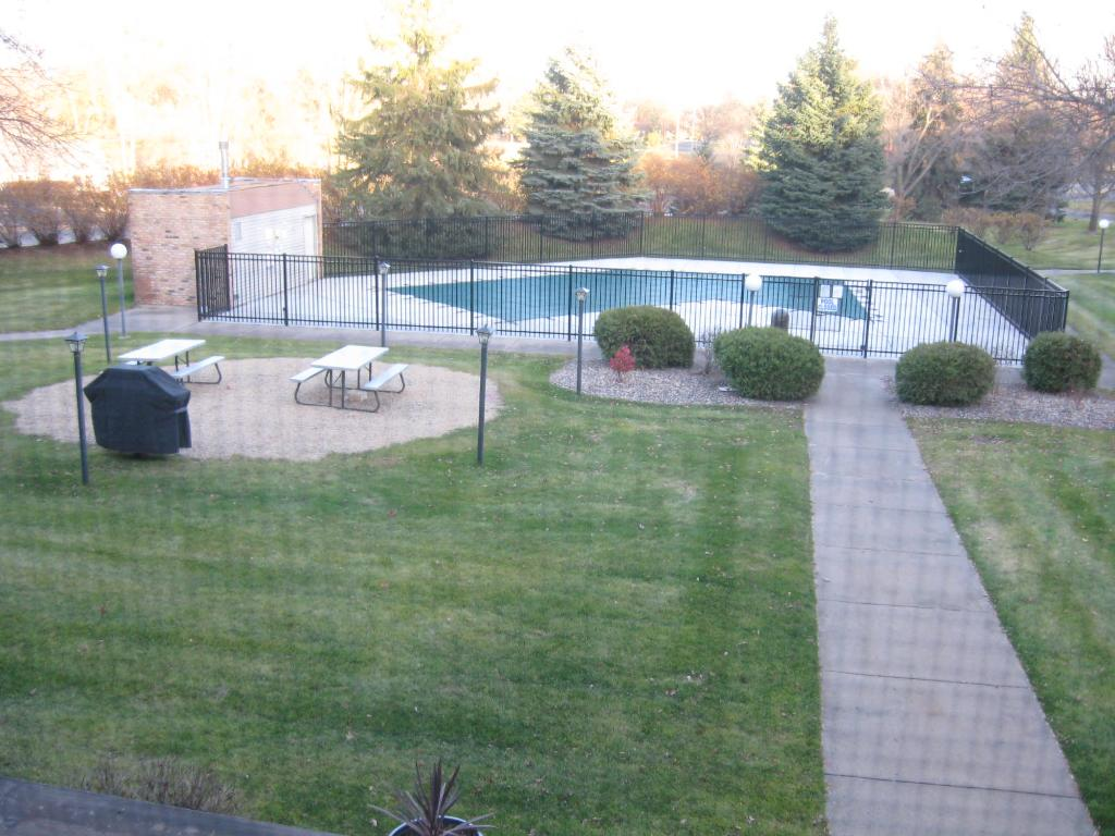 OUT DOOR HEATED POOL IS GATED AND HAS A PICNIC AREA, TABLE AND A GRILL