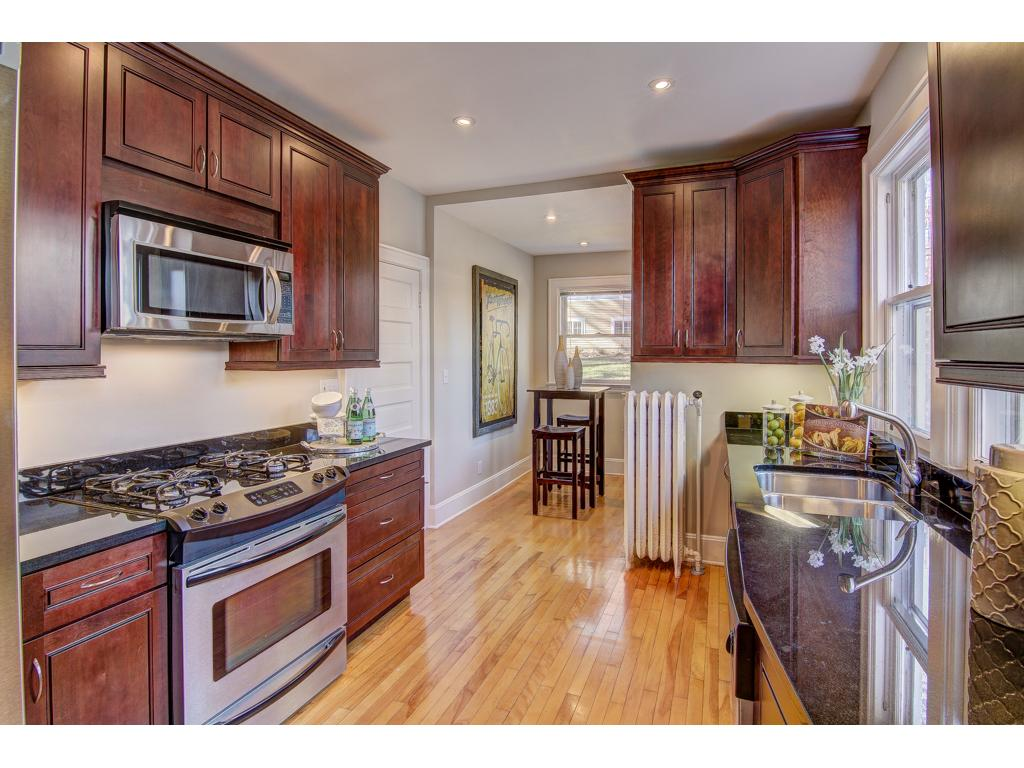 Updated Kitchen with Stainless Steel Appliances, Granite Counters, Custom Cabinetry, Under-Cabinet Lighting and Breakfast Nook!
