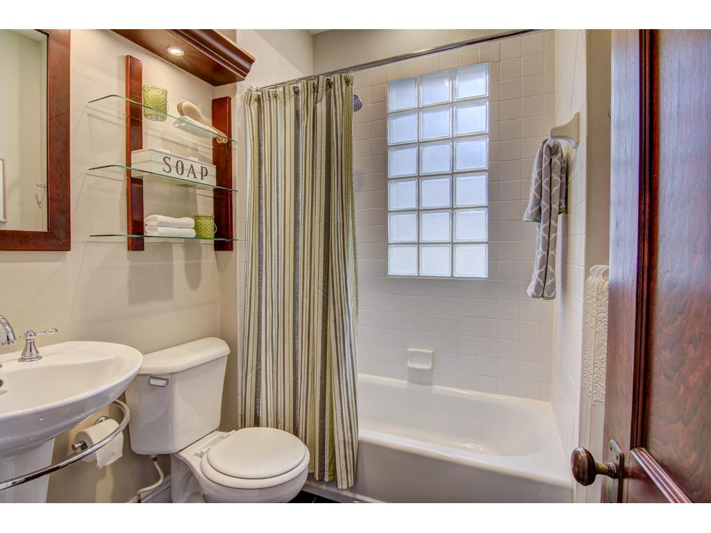 Remodeled Bathroom with Updated Ceramic / Granite. Custom Medicine Cabinet with Wood and Glass Shelves