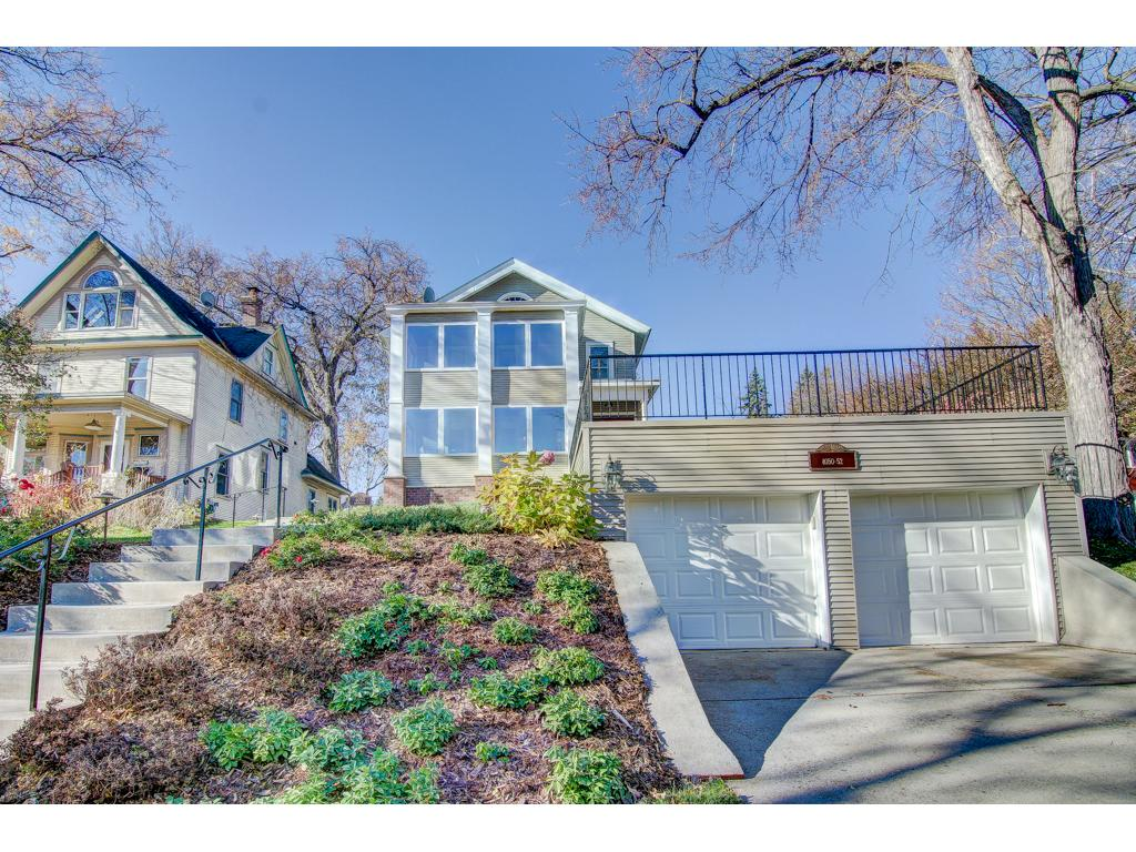Street View of Home with Garage and Patio. Lots of Yard Space and beautiful outdoor patio!