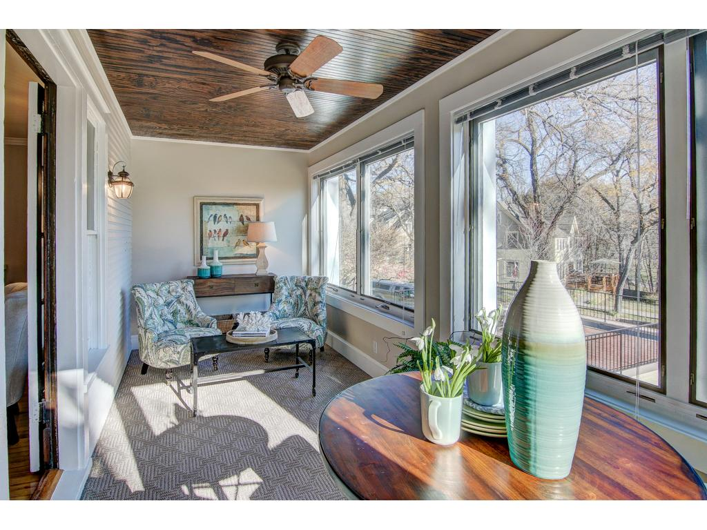 The Four Season Porch / Sun Room - flooded with sunlight, overlooking Lake Harriet.