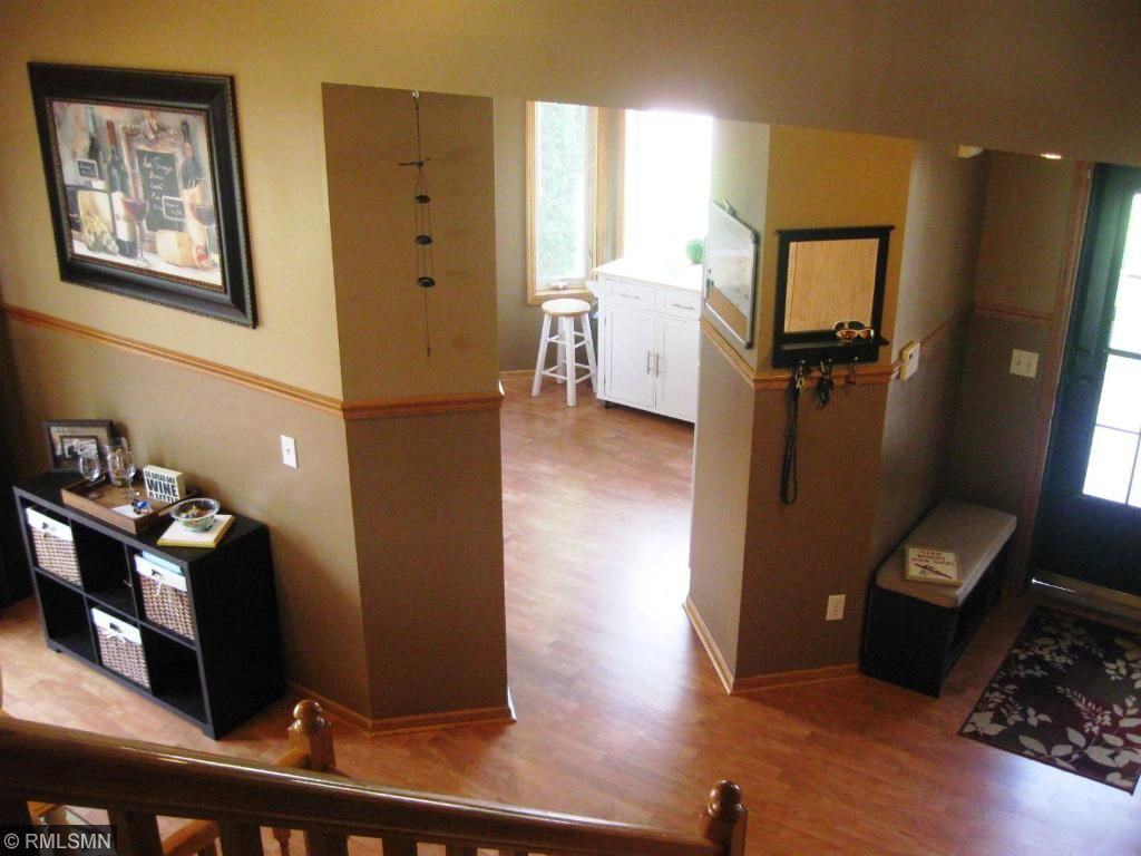A look from the upper level showing the kitchen entry and great foyer space.