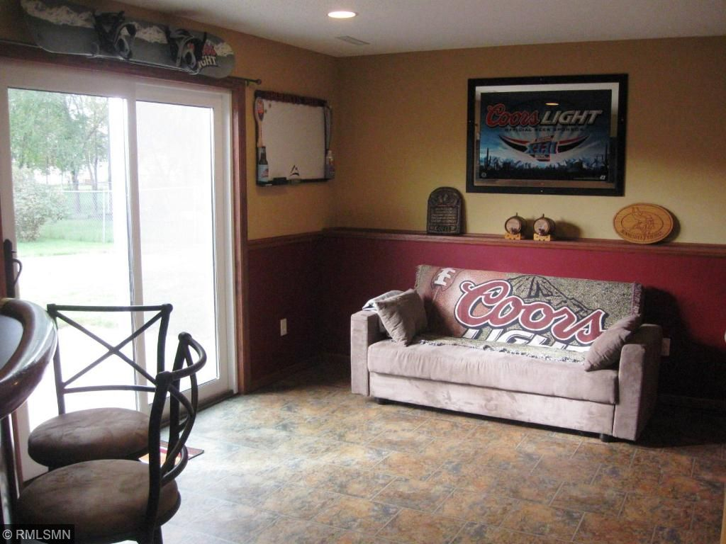 Lower level family room, walk out to a great patio and even greater back yard!  New patio door too!