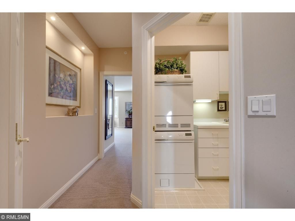 laundry room with Asko washer and dryer.