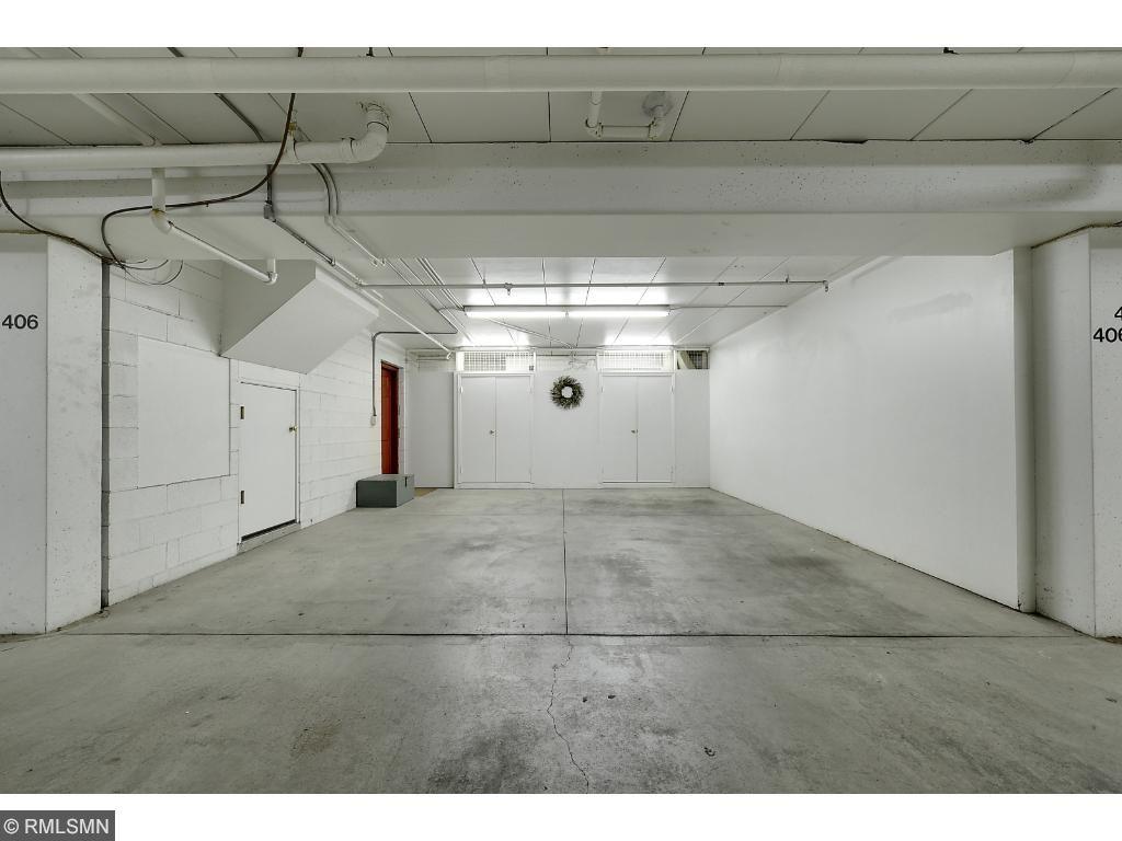 2 underground heated garage stalls with locked storage cabinets.