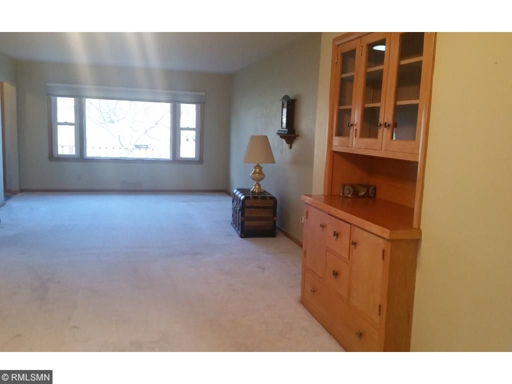 This view is from the dining area, attached to the living room.  Notice the built in buffet/hutch.  This is a spacious room for entertaining.  You also have access to the 3 season porch.