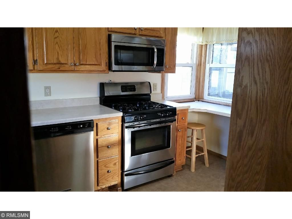 The kitchen is so large it deserved 2 photos!  Notice the extra 2 window to the right of the stove, with a work area.  Lots of natural sunlight in this kitchen!  Plenty of room for your cooking adventures.