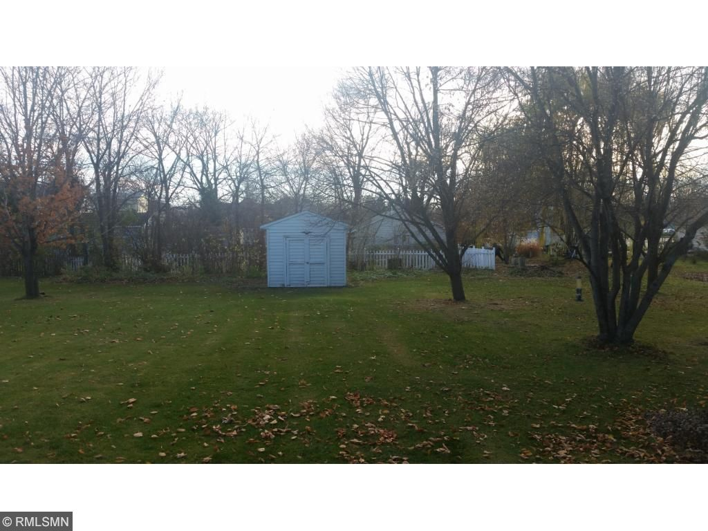 Here is the view from the 3 season porch.  This is a nice, flat lot that will accommodate pets, children, gardening.  There is a 10 x 11 shed for extra storage outside the 2 car garage.