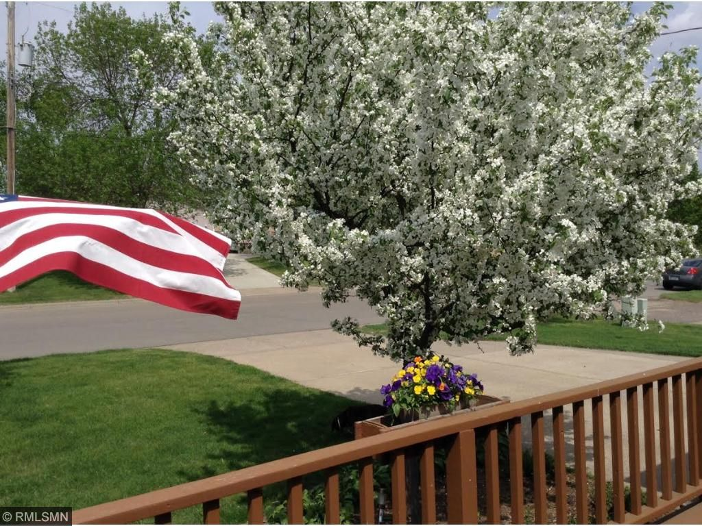 There is a flowering crab tree in the front of the home that blooms beautifully in the spring.  There are perennials around the large front porch.  Every season in this home is a treat.
