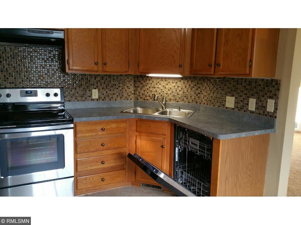 Beautiful glass tile back splash.Premium dishwasher has stainless interior