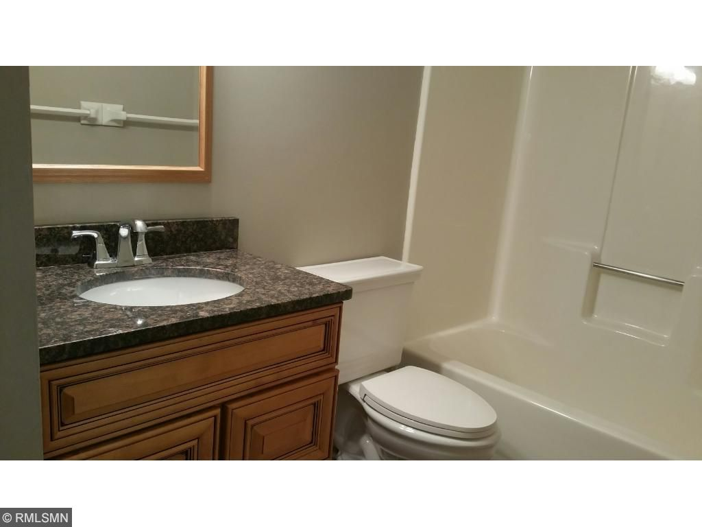 Beautiful granite highlights this recently remodeled bathroom