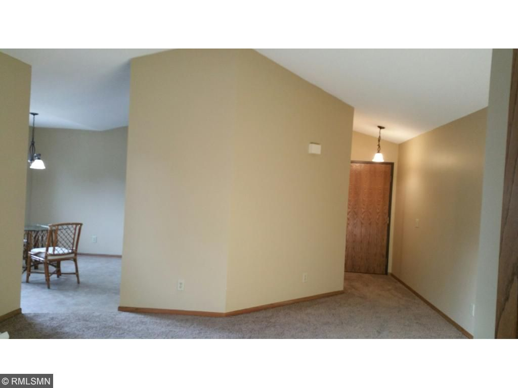 NEW carpet thru-out and freshly painted!Vaulted ceilings in living room and kitchen