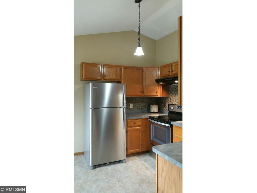 Vaulted ceiling in kitchen and updated lighting.