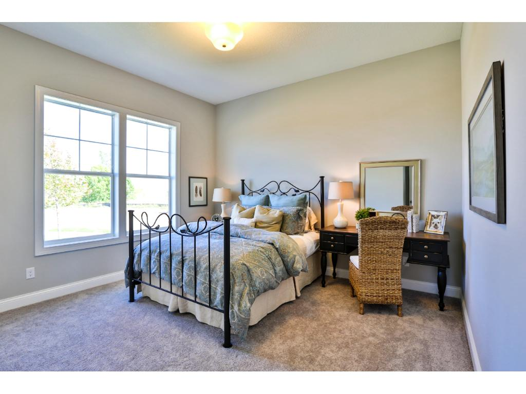 Picture of similar home, to show space furnished. Finish level comparable but options may differ.