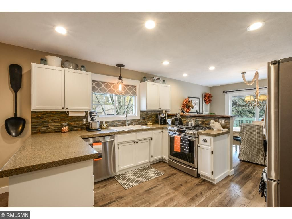 Remodeled Kitchen With Granite Tops, Back Splash, New Stainless Appliances,  Engineered Laminate Floor