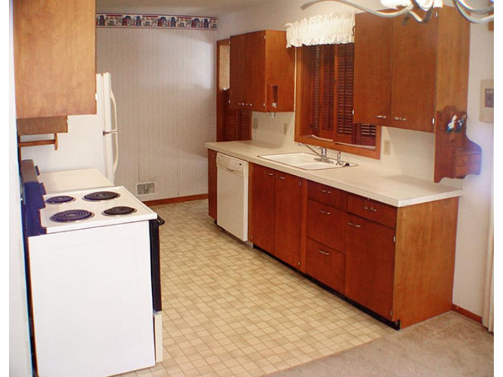 Pass through over sink opens to family room, so many ways to enjoy this home!