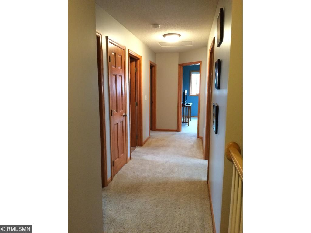 Upstairs Hallway Leads to the 3 Bedrooms, Laundry Room and Full Bath