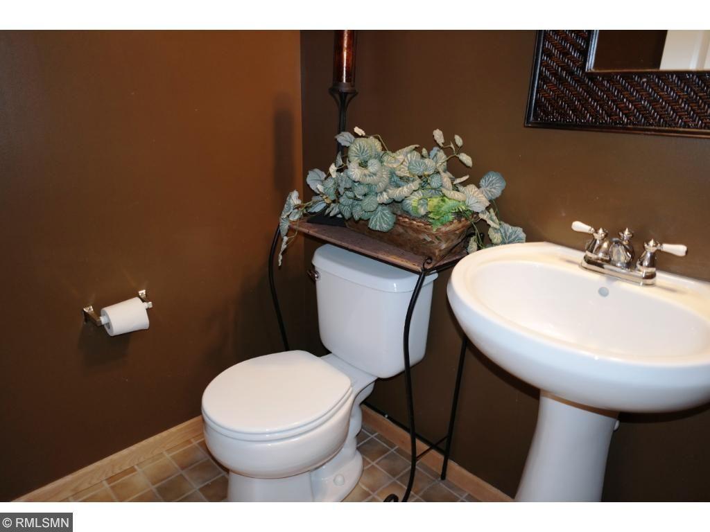 Main level 1/2 bath with tiled flooring.