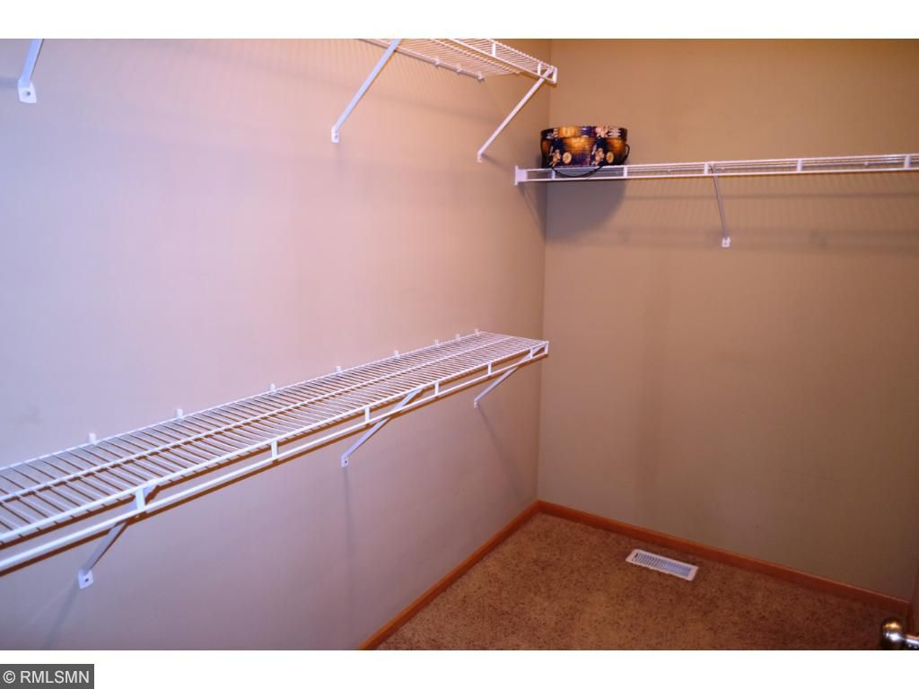 """Spacious and sizable walk-in closet providing you room for """"All"""" your clothes and shoes!! This isn't a closet, it's a room!!"""