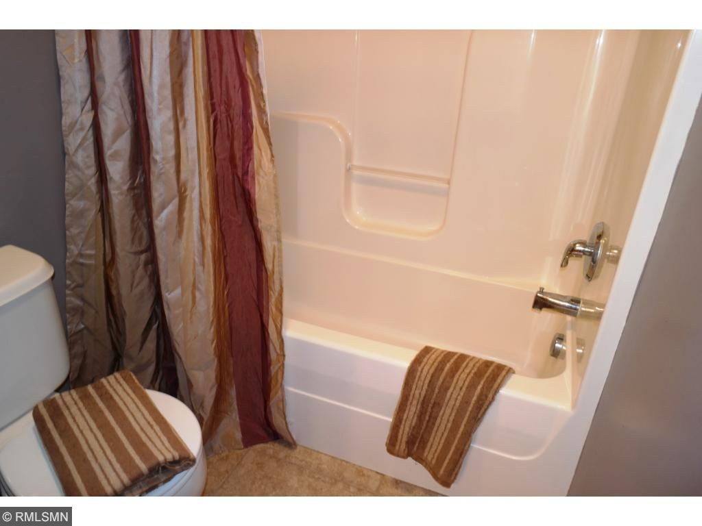 Upper level full bath with separate sink and water closet area. This bathroom is joined by the loft area and one of the upper level bedroom!!