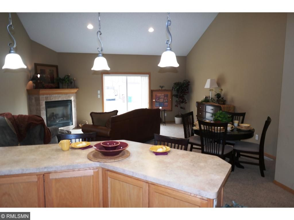 Large breakfast bar island that easily will see 4 or 5 bar stools!! There is no lack of cabinetry in this kitchen!! Compare other newer construction homes you will not find the same price per finished square foot.