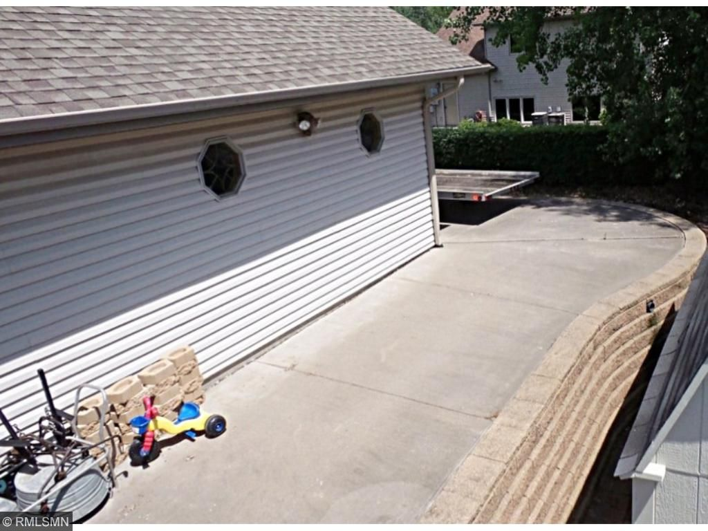 A concrete driveway behind the garage offers  perfect parking options for trailers, RV's and boats.