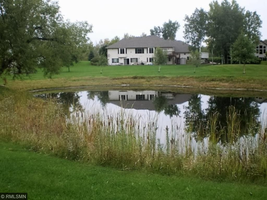 Enjoy the scenic views of the pond that borders the back lot line (shared with the neighbor).